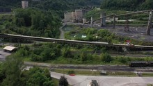 Panning To The Right View Of Train Tracks, Rail Cars, And Elk Run Coal Mine And Processing Facility.