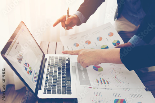 Fotomural Team of business investment consultant analyzing company annual financial report balance sheet statement working with documents graphs