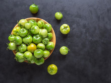 Green Tomatoes In A Bowl On A ...