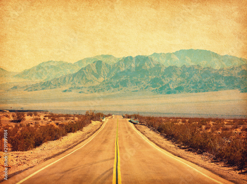 Spoed Fotobehang Route 66 Route 66 crossing the Mojave Desert, California, United States. Photo in retro style. Added paper texture. Toned image