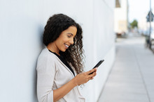 Natural Young Woman Reading An Sms On A Mobile