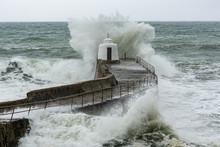 Sea Crashing Over The Pier At Portreath