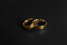 Elegant Gold Wedding Rings On Black Background