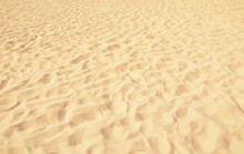 Golden Beach Sand On Sunny Day As Background