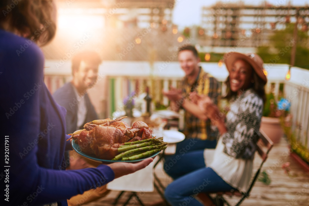 Fototapety, obrazy: Group of diverse friends having dinner al fresco in urban setting