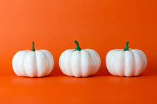 White Pumpkin On Orange Backgr...