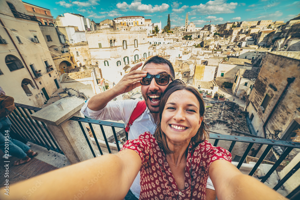 Fototapety, obrazy: happy tourist travelling in south of italy, posing in a selfie photo in Matera, Basilicata, unesco site, capital of culture 2019