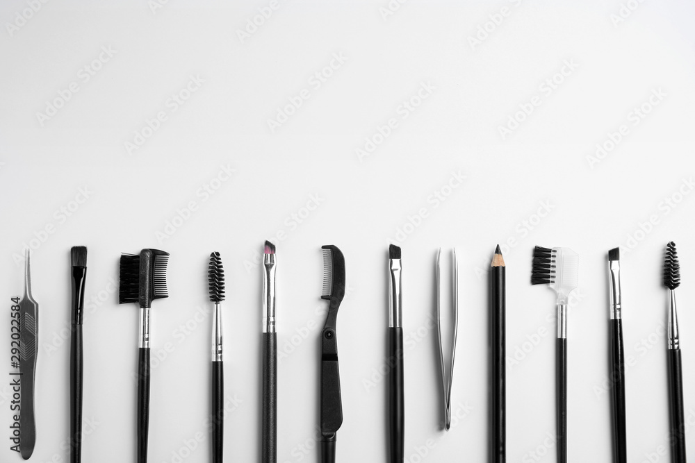 Fototapety, obrazy: Set of professional eyebrow tools on white background, flat lay. Space for text