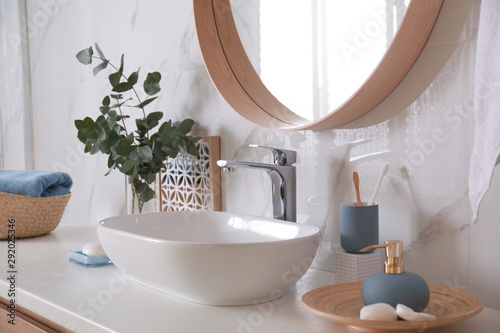 Stylish bathroom interior with vessel sink and decor elements