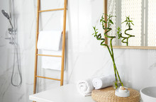 Tropical Bamboo Stems With Leaves In Stylish Bathroom Interior