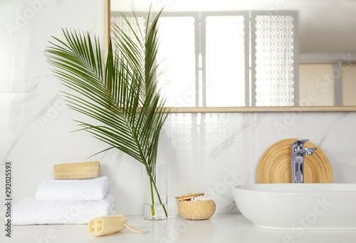Tropical palm leaves in stylish bathroom interior Canvas Print