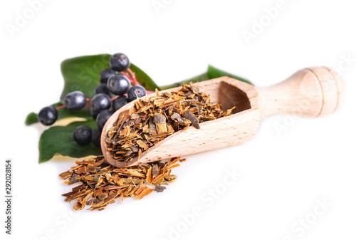 Photo Buckthorn bark in wooden scoop