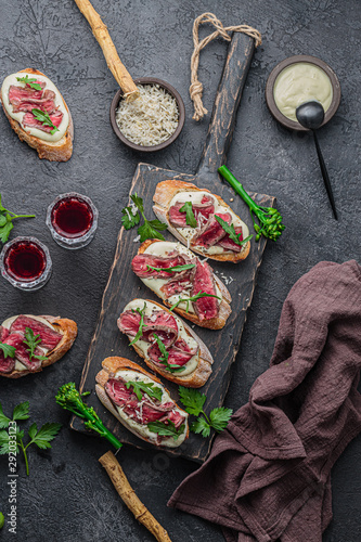 Bruschettas with beef on wooden board, copy space - 292033123