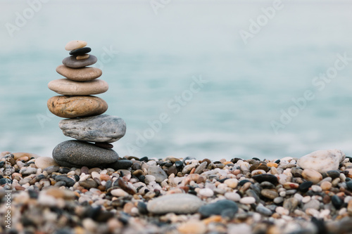 Stacked rounded stones at sea Canvas