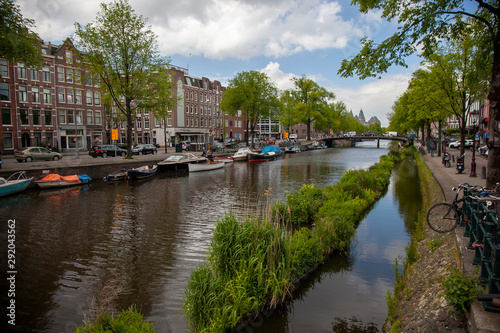 Photo  Embankment of Amstel canal in Amsterdam at summer day, Netherlands