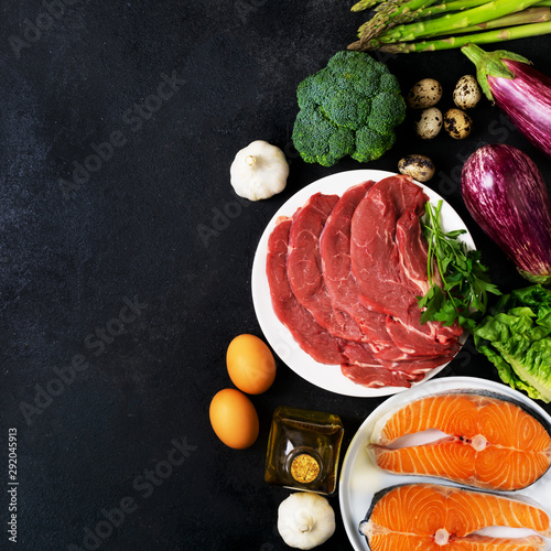 Photo Atkins Diet food ingredients on balck chalkboard, health concept, top view with