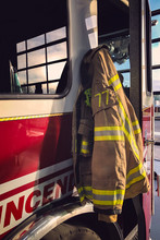 Firefighter Clothe Hanging On The Firetruck In The Fire Station