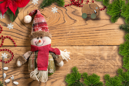 Poster Asia Country Christmas decoration and snowman rag doll on wooden background