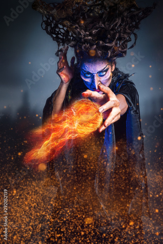 Scary witch conjuring a fireball