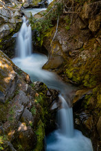 Water Streams Through Carved Rocks Above Christine Falls