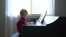 Upset Boy Plays The Piano.