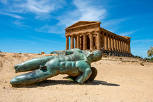 Bronze Statue Of Icarus In Front Of The Ruins Of The Temple Of Concordia At The Valley Of The Temples Near Agrigento On The Italian Island Of Sicily