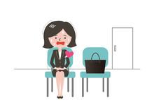就活の面接で緊張する女性