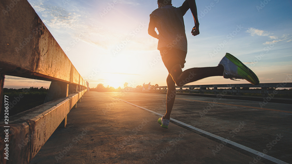 Fototapeta Athlete runner feet running on road, Jogging at outdoors. Man running for exercise.Sports and healthy lifestyle concept.