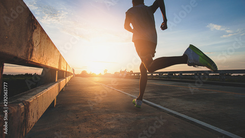 Photo Athlete runner feet running on road, Jogging at outdoors
