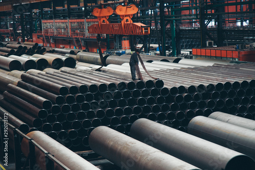 Fotomural heavy industry concept, construction machinery - long metal pipes inside a large room
