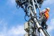 Leinwandbild Motiv technician working on high telecommunication tower,worker wear Personal Protection Equipment for working high risk work,inspect and maintenance equipment on high tower.