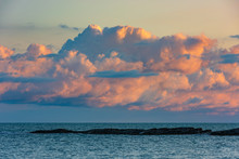 Big Colorful Cloud Over The Ocean