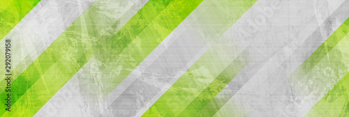 Obraz na plátne Tech green stripes on abstract grey grunge corporate header banner