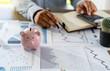 Leinwanddruck Bild - businessman working using a calculator finance accounting concept achievement to balance man assistant accounting