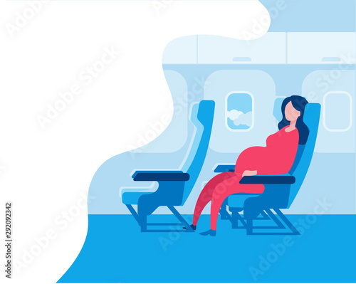 Pregnant woman sitting in an airplane seat. Canvas Print
