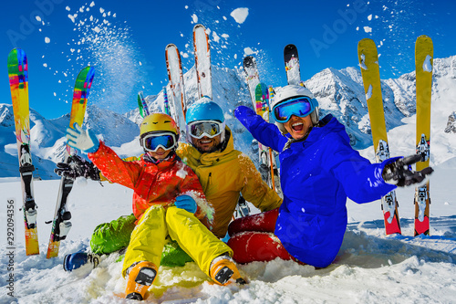 Photo sur Toile Ecole de Danse Happy family enjoying winter vacations in mountains. Playing with snow, Sun in high mountains. Winter holidays.