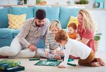 Happy Family Playing Board Gam...