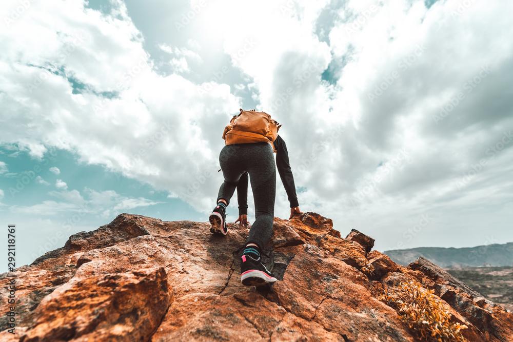 Fototapety, obrazy: Successful hiker hiking on mountain peak.