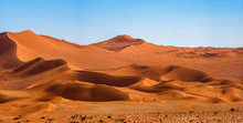 Panorama Landscape Of Orange Sand Dune Desert With Clear Blue Ky At Namib Desert In Namib-Naukluft National Park Sossusvlei In Namibia.