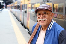 Senior Hispanic Man At Train S...