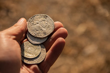 Ancient Silver Coins In Hand