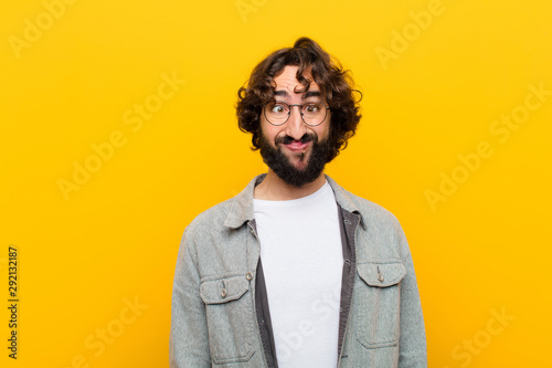 young crazy man looking goofy and funny with a silly cross-eyed expression, joki Wallpaper Mural