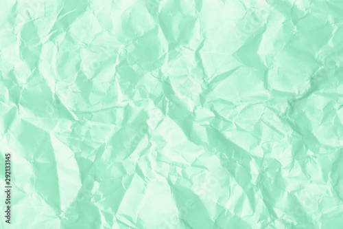 Texture of crumpled paper. Trendy mint background. Fototapet