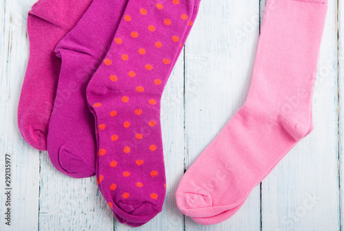 pink socks on white wooden