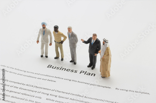 a figure of Business Team Discussing Over Market Research Canvas Print