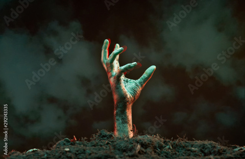 Photo Image of zombie hand sticking out of grave.