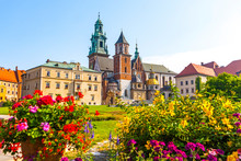 Summer View Of Wawel Royal Castle Complex In Krakow, Poland. It Is The Most Historically And Culturally Important Site In Poland. Flowers On A Foreground