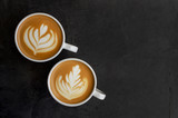 Hight quality made cappuccino in two white cups.