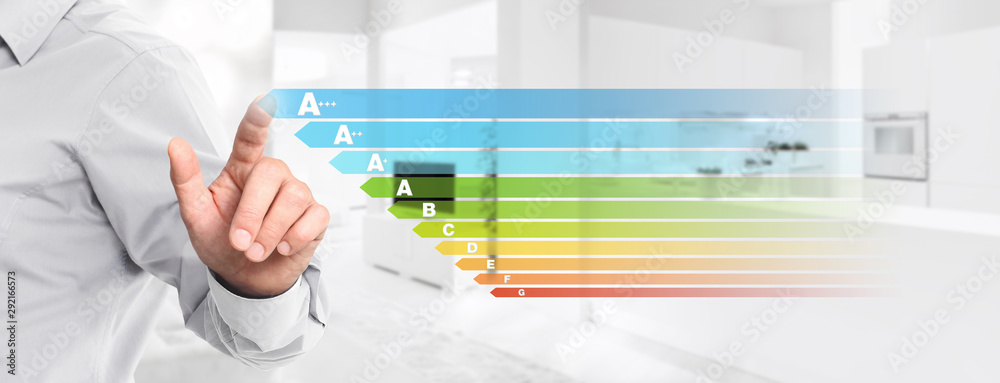 Fototapety, obrazy: energy efficiency hand touch screen with colored symbols on interior kitchen background web banner and copy space template