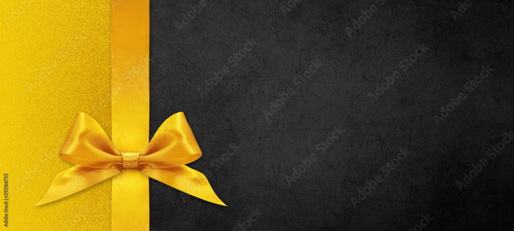 Fototapeta black gift card with golden ribbon bow, black friday concept